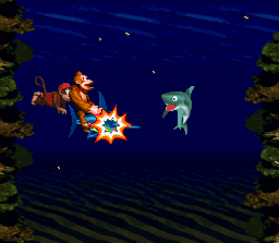 Donkey and Diddy on Enguarde the Swordfish charging a Chomps.