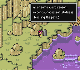 (For some weird reason, a pencil-shaped iron statue is blocking the path.)