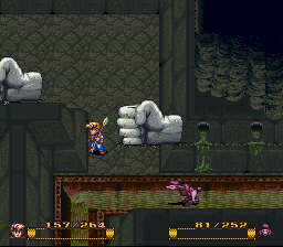 In a dungeon with Fist shaped statues.